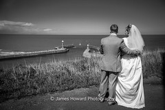 Looking ahead (jameshowardphotography) Tags: wedding white black beach wet water clouds pose groom bride cliffs whitby