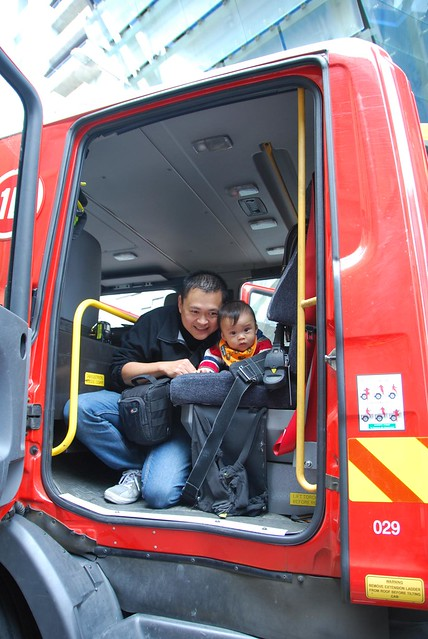Isaac and daddy in the fire engine - photo by Julia