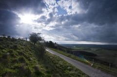 breaking through, combe (justyourcofchi) Tags: road light sunset england sky sun nature grass clouds countryside spring model flickr photographer hill british rays berkshire coombe gibbet wallbury chiarnold justyourcupofchicom justyourcupofchi