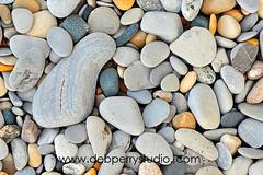 Water-smoothed stones (Deb Perry Studio) Tags: texture beach nature rock outdoors rocks stones michigan stock hard lakemichigan textures rockbeach stockphotography travelphotography smoothstones debperrystudio fishermanislandstatepark