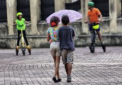 Two kids and an umbrella (Sallyrango) Tags: two kids umbrella children dominicanrepublic candid caribbean santodomingo cutekids twochildren candidkids