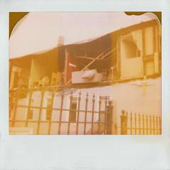 (Azarah Eells) Tags: chicago abandoned film analog polaroid explosion pilsen lightleaks abandonedhouse polaroidspectra expiredfilm instantfilm expiredpolaroid