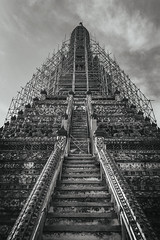 Temple of Dawn (tylerkingphotography) Tags: city travel sky blackandwhite bw tower faience monochrome clouds stairs lens thailand photography nikon southeastasia khmer photographer outdoor bangkok steps kingdom buddhism explore backpacking thai scaffold kit 1855mm traveling wai amateur porcelain watarun chaophrayariver prang templeofdawn d3100 yaidistrict watarunratchawararamratchawaramahawihan