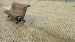 (Catherine...) Tags: portugal rain bench lisboa chuva banco cellphone pluie rainy lisbonne