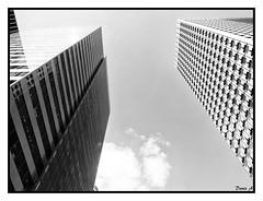 Verticalit - Verticality (baladeson) Tags: light sky bw abstract france building monochrome architecture clouds reflections blackwhite noiretblanc lumire ciel nuages reflets immeuble ladfense hautsdeseine