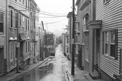 Bowen Street, South Boston (Patrick Copley) Tags: film rain boston 35mm landscape cityscape streetscape southboston canonae1p ilford3200 southie ilforddelta3200 bowenstreet canonfd35mmf20 chromenose concavelens bwfp thoriumlens