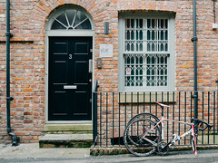 Bicycle #016 (Peter.Bartlett) Tags: door city uk urban colour brick window bike sign fence manchester unitedkingdom doorway cycle drainpipe m43 lunaphoto urbanarte vsco microfourthirds peterbartlett olympusomdem1 kodakportra160emulation