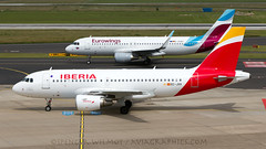 Iberia And Eurowings At Dusseldorf. (spencer.wilmot) Tags: aviation a319 iberia ibe ib ecjxc dus dusseldorf eddl eurowings ew ewg daewa a320 sharklets airplane aircraft airliner airport apron airbus taxiway plane jet jetliner aerobrand interbrand newlivery mediumhaul shorthaul