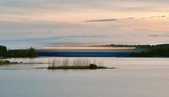 Escaping the Sunset (Kojaniemi) Tags: longexposure light sunset sea reed forest island boat spring woods ship may beacon isle springtime archipelago lighttrail oppositeshore bedofreeds kimmoojaniemi kojaniemi