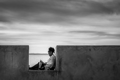 Woman reading at Morro's fortress BW (hzeta) Tags: woman reading mujer leyendo book libro read lectura fortress fortaleza morro brazil sao paulo sky sea cielo mar peace paz tranquility tranquilidad black white blanco y negro bw bn