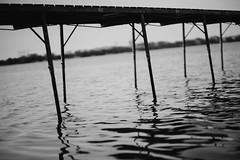 Under The Pier (Dan Constien) Tags: summer blackandwhite water pier waves mendota lakemendota sonya7