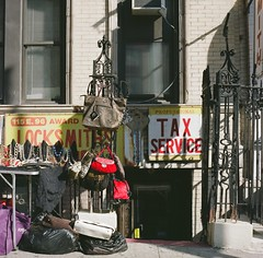 Tax Service (Scene of the Crime) (12th St David) Tags: newyork 120 6x6 film fence mediumformat shadows gates manhattan tax handbags storefronts stores uppereastside necklaces 75mm mittelformat rolleicordv locksmiths fuji160s fujipro160s carnegiehill formatomedio taxservice 700nm  schneiderxenar75mmf35 lemoyenformat f221125