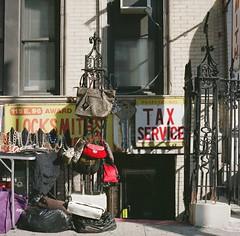 Tax Service (Scene of the Crime) (12th St David) Tags: newyork 120 6x6 film fence mediumformat shadows gates manhattan tax handbags storefronts stores uppereastside necklaces 75mm mittelformat rolleicordv locksmiths fuji160s fujipro160s carnegiehill formatomedio taxservice 700nm среднийформат schneiderxenar75mmf35 lemoyenformat f221125