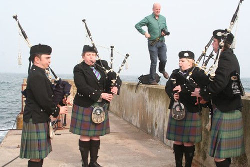 PIpers with Paddy/Harry on wall
