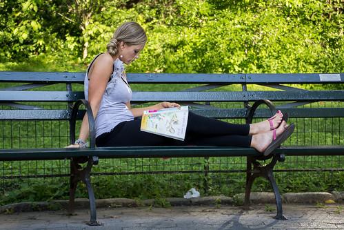 park nyc pink red woman newyork green yoga magazine bench reading pants centralpark sandals blonde toenails