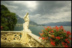 Sentinel (flyingtoadphotography) Tags: flowers italy lake storm como colour gardens statues villa guardian lenno nd400 balbianello villadelbalbianello