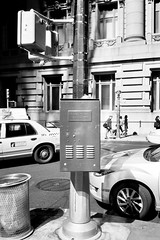 Traffic Control (12th St David) Tags: bw newyork film trash 35mm garbage noiretblanc manhattan taxi can bin financialdistrict rubbish olympusxa trafficcontrol fujiacros100 schwarzweis schwarzundweiss fzuiko35mmf28
