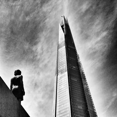 Towering ({Laura McGregor}) Tags: city urban blackandwhite sculpture london tower architecture londonbridge grain olympus noise shard towering morelondon iphone theshard snapseed lauramcgregorportfolio olympupenep1