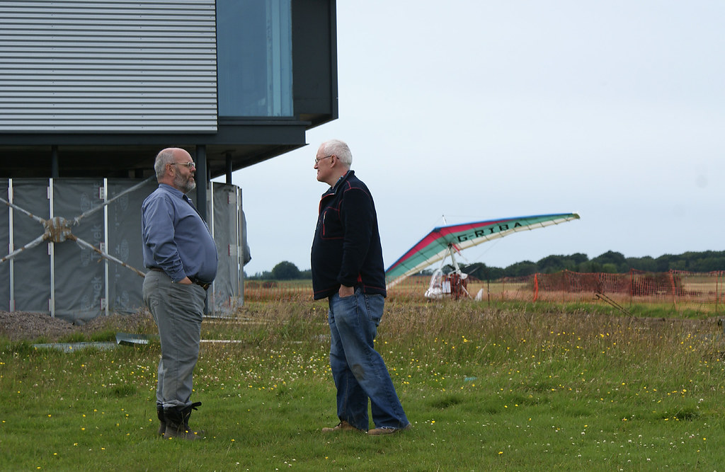 Richard and client, Colin, talk business while Richard's plane, G-RIBA, looks on approvingly