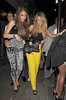 Chloe Sims and Lauren Pope outside Funky Buddha nightclub. London, England