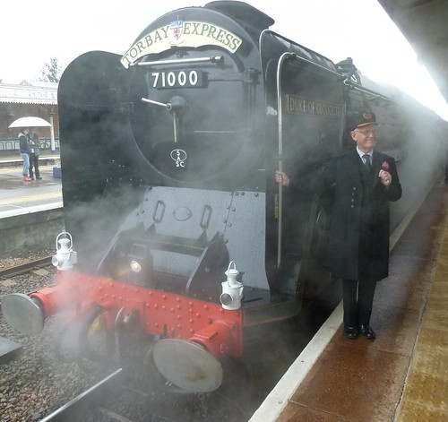 Victorian Station Master appears by heritage steam loco