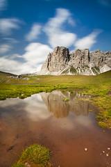 Crises (Coveredinice [cara ragazza d'altri tempi]) Tags: blue italy orange cloud mountain lake mountains alps verde green grass rock clouds montagne lan