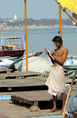 india- varanasi (gerben more) Tags: shirtless people india temple boat varanasi administration youngman ganges benares ghat