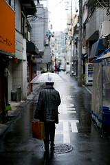 Walking in the rain (大阪市) (Rob₊Lee) Tags: rain umbrella osaka 大阪市