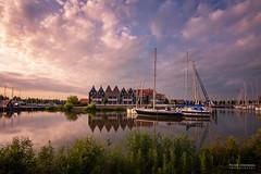 Evening in Volendam (pieter.struiksma) Tags: sky water netherlands dutch marina reflections landscape evening harbor volendam