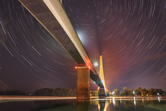 Time Warped (reflectioninapool) Tags: guyandotte ohio ohioriver westvirginia angle architecture astrophotography below blue bridge cablestay cables city color horizontal landscape lightpollution lights longexposure night purple rectangle river road startrails stars steel under water