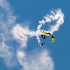 Swirling to Earth (tomkellyphoto) Tags: sky usa utah hill planes skydive airforce ogden skydiver usarmy paratrooper hillafb goldenknights hillairforcebase airshowwarriorsoverthewasatch