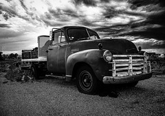 Riding the storm. (pmpiasecki) Tags: blackandwhite monochrome clouds truck landscape monotone oldtruck ricohgr ricohgr2