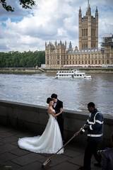 The Fairytale Bride (Silver Machine) Tags: london westminsterbridge wedding weddingdress bride groom weddingphotograph cleaner sweep sweepingbrush housesofparliament fujifilm fujifilmxt10 fujinonxf35mmf2rwr