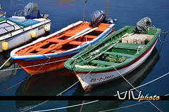Barcas. (vivndum) Tags: blue sea espaa orange verde green colors azul port boats puerto mar spain nikon colores galicia galiza porto barcas naranja nfa portodoson d3100
