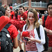 Students line up to receive giveaways during the first Red Friday event on the Brickyard.