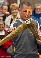 Passing the flame, Burrelton (P&KC Archive) Tags: sport photography scotland community perthshire streetscene celebration 20thcentury relay olympicflame torchrelay localhistory olympictorch torchbearers historicevent civicpride perthandkinross ecsochistory recordinghistory