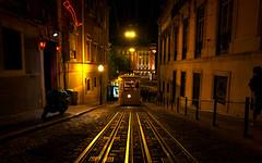Lisbon Tram (Luminor) Tags: travel colour portugal lines rock night train lights cafe lowlight nikon warm availablelight lisboa lisbon f14 hard tram 24mm leading localscenes d700