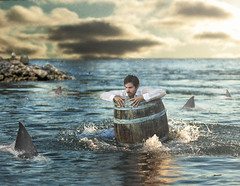 Barreled and Swarmed (RC Davis) Tags: ocean storm man clouds jetty fear fineart barrel surreal sharks isolation splash fineartphotography