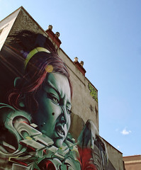 (e_alnak) Tags: greatbritain chimney urban streetart building art girl graffiti mural paint angle britain terrace head character edificio large sunny spray urbanart massive huge housing publicart piece aerosol striking shining towering monumental photorealistic photorealism  terracedhouses nextlevel epok vitamind largescale upfest whopping smugone epokone behemothic smuglife