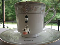 black and white cow tea (Prim*Rose*Hill) Tags: tea infuser teaball