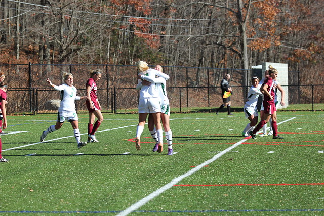 Jenna Quaranta (3) races to join Victoria Vasapolli and Chelsea Grace after Grace scored the games' lone goal in the 58th minute