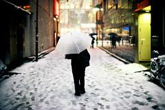 Getting There (OzGFK) Tags: city winter snow man cold film japan analog umbrella tokyo alley asia snowstorm lane akihabara snowing cbd nikkor nikonfm3a ektar100