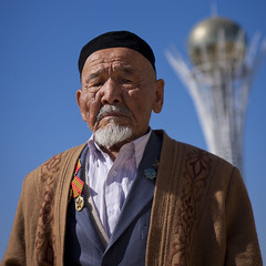 Old Veteran In Front Of Baiterek Tower, Astana, Kazakhstan (Eric Lafforgue Photography) Tags: portrait people man building male tower monument architecture standing square beard asian outside army outdoors person war exterior military capital structure lollipop veteran centralasia kazakhstan kazakh humanbeing sights easterneurope astana contemplation lookingatcamera waistup squarepicture lookingcamera akmola baiterektower akmolinsk kz5251 bigchupachups