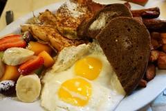 Big Breakfast at Gayley's Cafe (deeeelish) Tags: fruits potatoes egg sausage banana frenchtoast sunnysideup ryebread