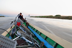 Enjoy the cool and pleasant wind after sunset. (Go Go Janet) Tags: bicycle moving wind myanmar inlelake passing woodenboat redstar 110second timeriver