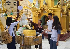 Bunrod  pours water over the Buddha statue (Bn) Tags: myanmar birma burma yangon rangoon former capitol street candid monk bikes taxi city six million people buddhist temple botataung pagoda botahtaung gautama buddha hair 2500 years old religions locals 40m high seaport dazzling road car gold kyats umbrella sunshine fietstaxi gate entree hollow destroyed rebuild colonial overwhelmed infrastructure slums pilgrims buddism traffic cycling shwedagonpagoda 2600years 99m cars busy devotees prayer 50faves topf50
