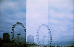 IMG_0007 (spoeka) Tags: lomo lomography analog analogue mittelformat square 120mm dia slide xpro zeissikonnettar51616 london uk lomoxpro200 sky himmel clouds wolken londoneye panorama berlappend overlap mx mehrfachbelichtung