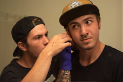 Logan Pierces His Ears (Cora Johnson) Tags: people boys brothers adorable ears piercing