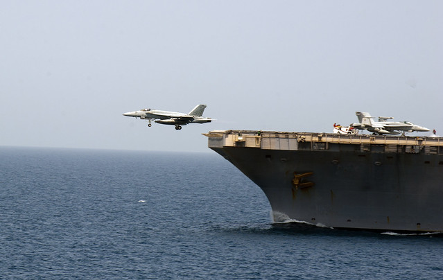 A jet launches from the USS Abraham Lincoln.