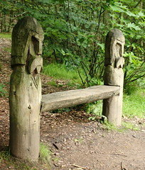 Carved Seat - AlternativeView, Newmillerdam (Anita K Firth) Tags: wood trees green faces fierce seat moustache heads wakefield helmets newmillerdam